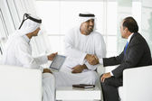 Three Middle Eastern men talking at a business meeting — Stock Photo