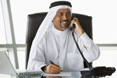 A Middle Eastern businessman talking on the telephone — Stock Photo