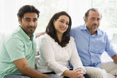 A Middle Eastern couple with their adult son — Stock Photo