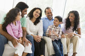 A Middle Eastern family sitting together on a couch — Stock Photo