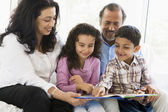 A Middle Eastern couple reading with their grandchildren — Stock Photo