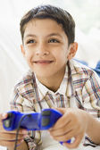 A Middle Eastern boy playing a video game — Stockfoto