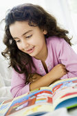A Middle Eastern girl reading a book — Stock Photo