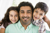 A Middle Eastern man with his children — Stock Photo