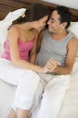 A Middle Eastern couple lying on a bed — Stock Photo