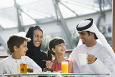 A Middle Eastern family enjoying a meal in a restaurant — Stock Photo