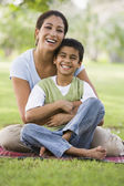 Mother and son relaxing in park — Stock Photo