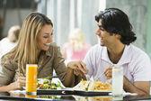 Couple enjoying lunch at cafe — Stock Photo
