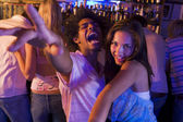 Young man and young woman dancing in a nightclub — Stock Photo
