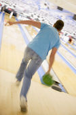 Man bowling, rear view (blurred motion) — Stock Photo