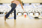 Woman bowling, rear view — Stock Photo