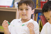 A schoolboy in a primary class — Stock Photo