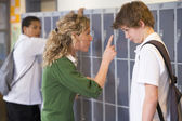A teacher telling a student off — Stock Photo