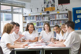 Schoolchildren studying in school library — Stock Photo