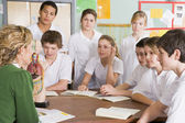 Schoolchildren and teacher in science class — Stock Photo