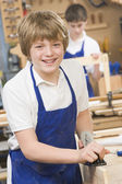 Schoolboy in woodwork class — Stock Photo