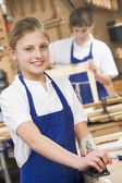 Schoolgirl in woodwork class — Stock Photo