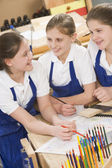 Schoolgirls in woodwork class — Stock Photo