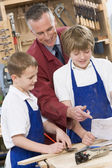 Schoolboys and teacher in woodwork class — Stock Photo