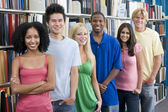 Group of university students in library — Stock Photo
