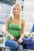 Female student sitting outside — Stock Photo