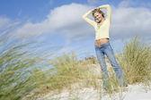 Young woman amongst dunes — Stock Photo