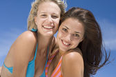 Female friends on beach together — Stock Photo