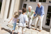 Grandparents welcoming grandchildren — Stock Photo