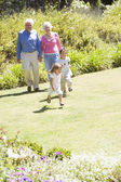 Grandparents walking with grandchildren — Stock Photo