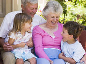Grandparents laughing with grandchildren — Stock Photo