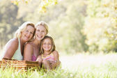 Grandmother with adult daughter and grandchild on picnic — Stock Photo