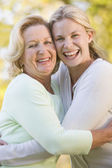 Mother hugging grown up daughter — Stock Photo