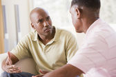 Two men in living room talking — Stock Photo