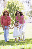Grandmother with adult daughter and granddaughter in park — Stock Photo