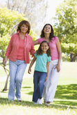 Grandmother with adult daughter and grandchild in park — Stock Photo