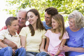 Extended family outdoors smiling — Stock Photo