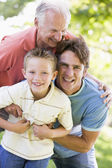 Grandfather with adult son and grandchild in park — Stock Photo
