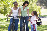 Grandmother mother and granddaughter bike riding — Stock Photo