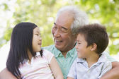 Grandfather laughing with grandchildren — Stock Photo