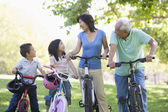 Grandparents bike riding with grandchildren — Stock Photo