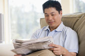 Man relaxing with a newspaper — Stock Photo