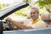 Man in convertible car smiling — Stock Photo