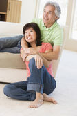 Couple relaxing in living room and smiling — Stock Photo