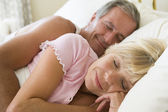 Couple lying in bed sleeping — Stock Photo