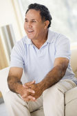 Man in living room smiling — Stock Photo