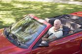 Man in convertible car smiling — Stock Photo