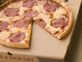 Pepperoni Pizza in a Take Away Box with a Slice Taken — Stock Photo