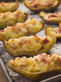 Stuffed Potato Skins a Tray with Sea Salt — Stock Photo