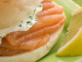 Smoked Salmon and Cream Cheese Bagel with a wedge of Lemon — Stock Photo