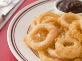 Battered Onion Rings worth Barbeque Sauce — Stock Photo